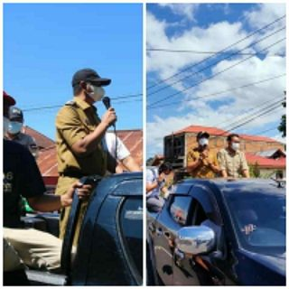 Bupati dan Wakil Bupati Boltim Turun Langsung ke jalan memberikan edukasi tentang bahaya virus corona.(foto:ist)